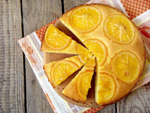 Polenta and orange butter cake. оn a wooden table royalty free stock images