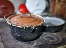 Polenta pot on ironcast stove Stock Images