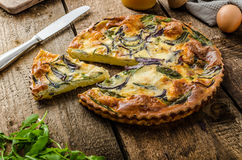 Polenta quiche with red onion and herbs Stock Image