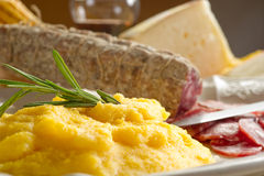 Polenta with salami Royalty Free Stock Photos