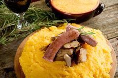 Polenta sausage and mushroom Stock Photo