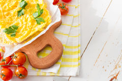 Polenta served on wood board with cherry tomatoes Royalty Free Stock Photos