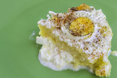 Polenta Slice. Polenta (mamaliga) slice with boiled eggs, sour cream and goat cheese on a green plate Stock Photography