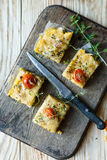 Polenta slices with cherry tomatoes, top view Stock Photo
