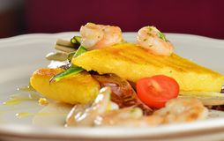 Polenta slices with shrimps Royalty Free Stock Photos