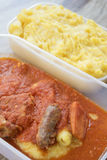 Polenta with spareribs and sausages in tomato sauces Royalty Free Stock Photo