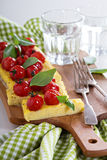 Polenta tart with baked tomatoes Royalty Free Stock Image