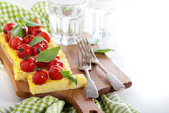 Polenta tart with baked tomatoes Royalty Free Stock Images
