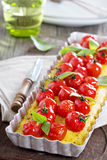 Polenta tart with baked tomatoes Stock Photography