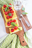 Polenta tart with baked tomatoes Royalty Free Stock Photography