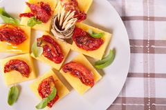 polenta,tomato and basil Royalty Free Stock Images