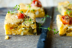 Polenta with tomato pieces on the board Stock Photography