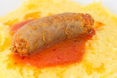 Polenta with tomato sauce with sausage Stock Photography