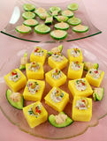 Polentas and Cucumber Rounds. Finger food of tuna filled polentas and cucumber rounds ready to serve Royalty Free Stock Photography