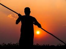 Poler en la puesta del sol Fotografía de archivo libre de regalías