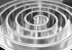 Polerad metallspiral grunt djupfält Arkivfoto