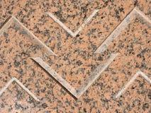 Polerad röd granit med svarta befruktningar Arkivbild