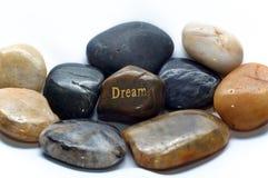 Polerade stenar med dröm vaggar arkivfoto