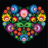 Polermedel slavisk folkkonstkonsthjärta med blommor på svart - wzory lowickie, wycinanka Fotografering för Bildbyråer