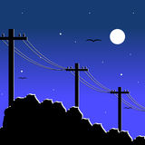 Poles. Electrical poles. Night and moon Royalty Free Stock Photos