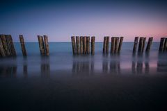 Poles on the beach. Stock Photography