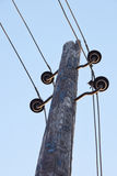 The poles with brackets and wires for the transmission of electricity Stock Photography