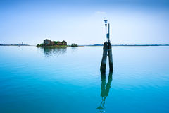 Poles light and small island in Venice and Burano water lagoon. Royalty Free Stock Photos