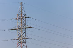 The poles of a power line against a blue sky high voltage power Stock Photo