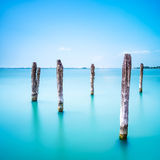 Poles and soft water on Venice lagoon. Long exposure. royalty free stock photo
