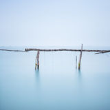 Poles and soft water on water landscape. Long exposure. Stock Photography
