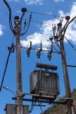 Poles with transformers. On a background of blue sky Stock Photography