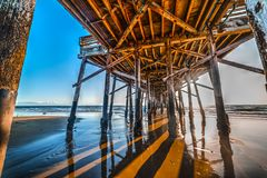 Poles under Newport Beach pier. California Stock Image