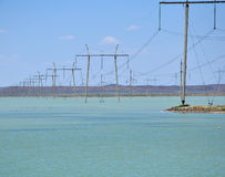 Poles in the water Stock Photography