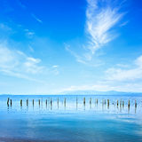 Poles and water on ocean landscape. Long exposure. Stock Photo