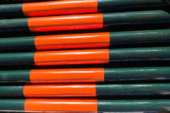 Poles Wood Green Orange. Green orange painted wood poles together equestrian show jumping equipment Stock Photography