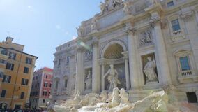 Poli Palace and popular Trevi fountain in Rome, Italy on a sunny summer day. Stock footage stock video footage