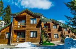 Wooden cottage among pine forest. Comfortable accommodation in the ski resort Bukovel. Polianitsa village, Ivanofrankivsk region, Ukraine - February 26, 2019 royalty free stock images