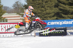 Poliaris #138 Snowmobile Flying High. EAGLE RIVER, WI - MARCH 2:  Poliaris #138 Snowmobile Flying High during a race on March 2, 2013 in Eagle River, Wisconsin Royalty Free Stock Image