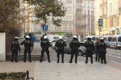 Policía antidisturbios - policía Imagenes de archivo