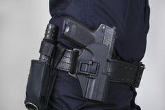 Policía con el arma imagen de archivo