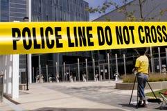 Policía-línea-cameraman Foto de archivo