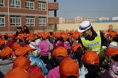 Policía y estudiantes Imagen de archivo libre de regalías