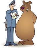 Policía y oso Imágenes de archivo libres de regalías