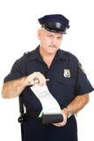 Policía con la citación en blanco Fotos de archivo