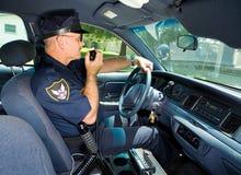 Policía en radio Foto de archivo libre de regalías