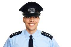 Policía joven sonriente Foto de archivo libre de regalías