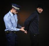 Policía y ladrón. Escena del robo. Imagenes de archivo