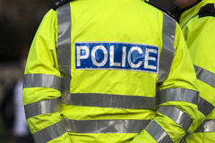 Police. Shot of the back of a police officer's jacket with the word police written across the back Stock Image