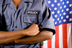 Police. Officer, background is american flag Royalty Free Stock Photo