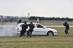 Police action 3. Detail of police defuse the delinquents ridden in a car Royalty Free Stock Images